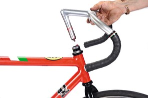 The Cinelli bar and stem pictured are a late 80s/early 90s track stem with big drop and a round criterium bar.