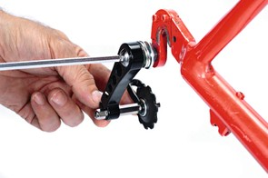 Grease the threads and install the tensioner in place of the old derailleur.