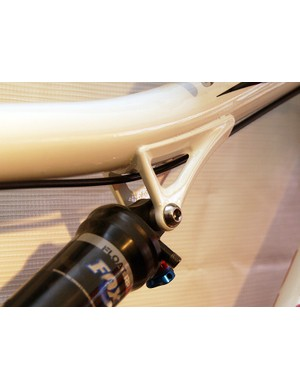 The upper shock mount is bonded to the top tube.