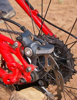 Shimano's latest XTR brake calipers are small and tidy.