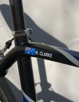 Clarke's name and Aussie flag is applied right where the top tube flows into the seat stay yoke.