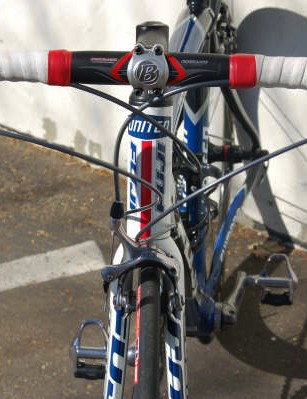 The team bike's front end is equipped  with a Bontrager handlebar, stem and bar tape.