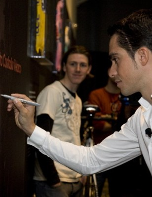 Alberto Contador signs his 'Wall of Fame' at Trek's Wisconsin headquarters.