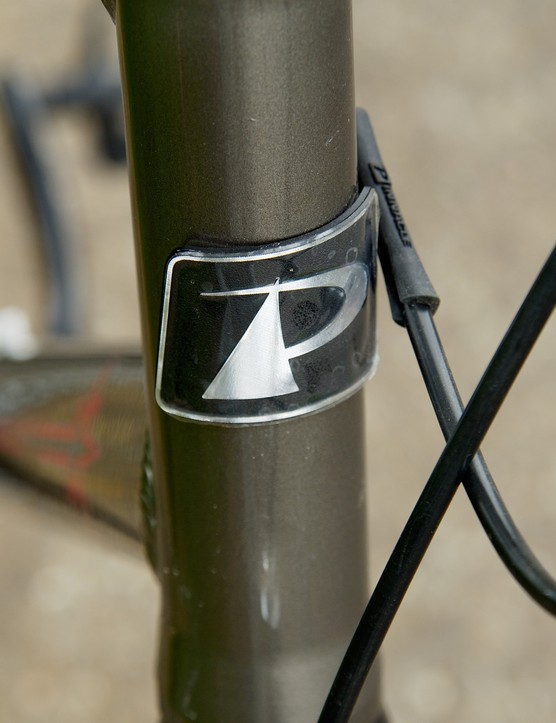 Raw, uniform TIG welding holds an industrial beauty and contrasts with the sculptured, flowing lines of the head tube