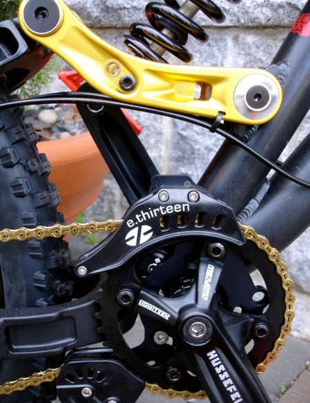 Gold chain and gold linkage with twin shock mounts. Functional and fly