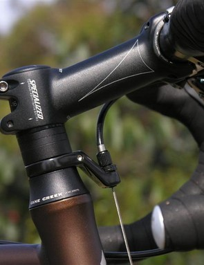 Bolt-on gear hanger makes stem adjustment easy by retaining fork