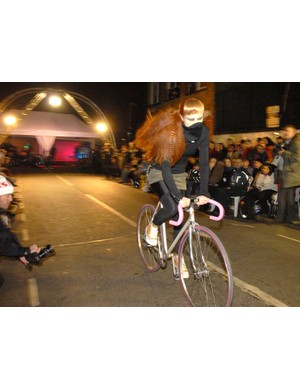 Not quite the catwalk - a model shows off fashionable bike gear at Heels & Wheels