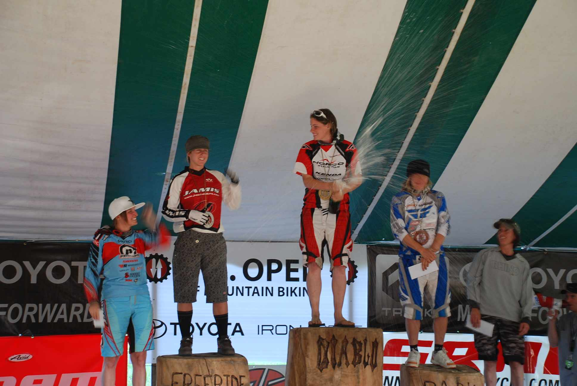 Fionn Griffiths on the podium, flanked by Kathy Pruitt and Jo Petterson