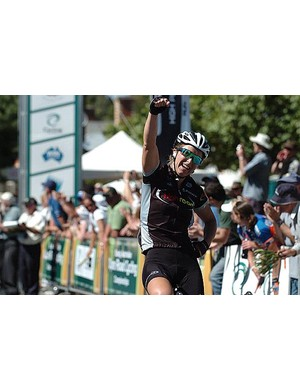 Oenone Wood (High Road) salutes as she wins the women's championship