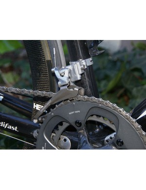 The Red front derailleur cage is made from titanium plate which isn't as stiff as steel but lighter