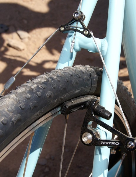 The Tektro cantilevers are wide-profile for more mud clearance.