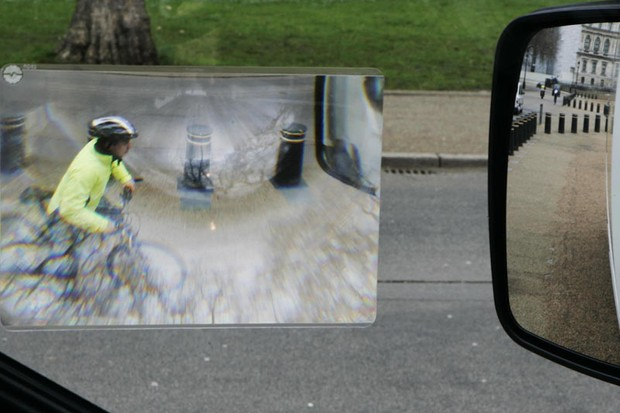 The Fresnel lens reveals an otherwise invisible cyclist