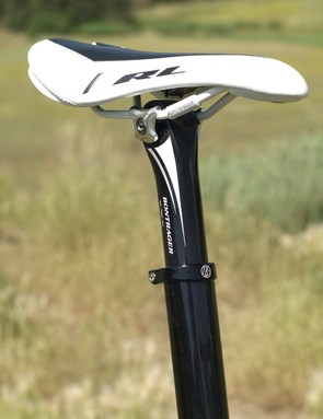 A shortie seat post gives enough seat adjustment that it's not necessary to trim the seat tube