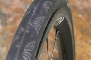 The C2 rim lets typical 23mm-wide tires spread out a little more for a bigger contact patch and better sidewall support.  HED also claims the resultant shape is more aero, too.
