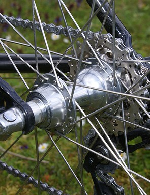There are no fancy aero wheels here, just box-section tubulars laced around Dura-Ace hubs.