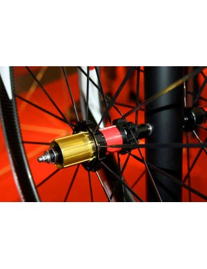 The rear hub has radial lacing	on the drive side and two-cross on the non-drive side.