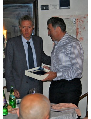 Valentino Campagnolo presents Eddy Merckx with a commemorative souvenir.