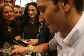 Ivan Basso signs autographs at the EICMA show in Milan