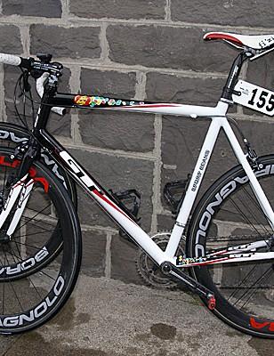 …while teammate Scott Tietzelhas to go with a custom-built aluminum frame.