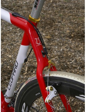 The housing stop for the rear brake is securely riveted on to the monostay and includes a handy barrel adjuste