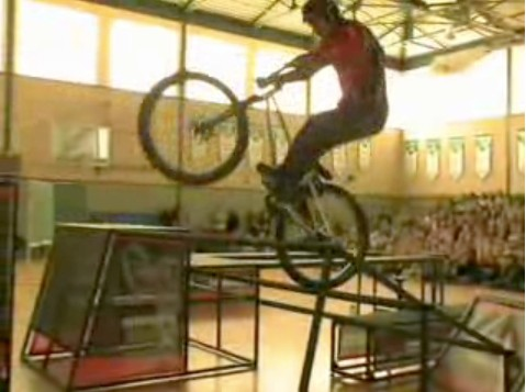 Canadian trials rider Ryan Leech performs in front of school kids in North America.