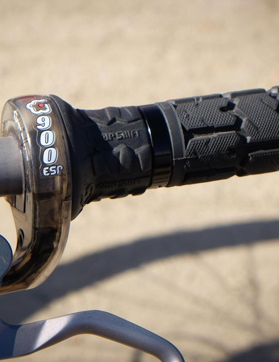 A Grip Shifter operates the front derailleur...