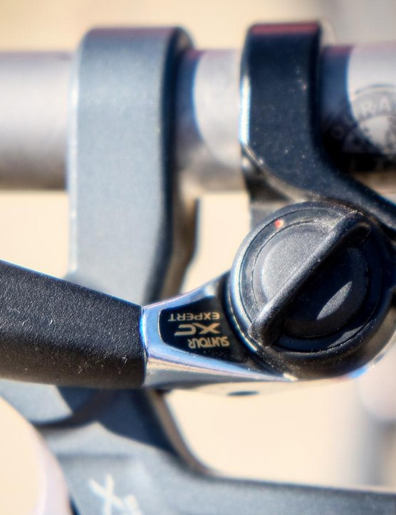 ...and a Suntour XC Expert thumb lever shifts through the 8-speed cassette