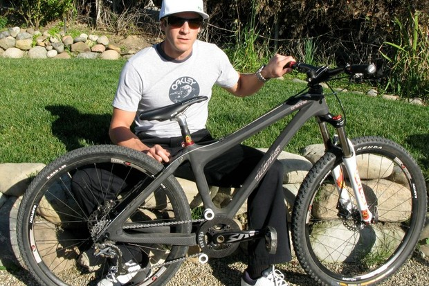 Brian Lopes shows off his new WTB Devo saddle, on top his carbon Ibis Tranny dirt jump hardtail.