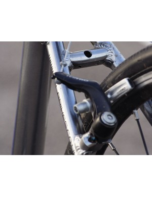 Tektro cyclo-cross canti brakes give excellent stopping power. The frame features mounts for racks a