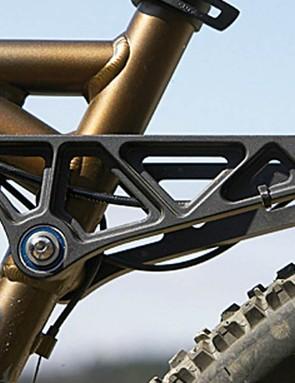 Despite the four-bar arrangement, the Kona behaves like it has a simple swingarm. The DHX shock cuts