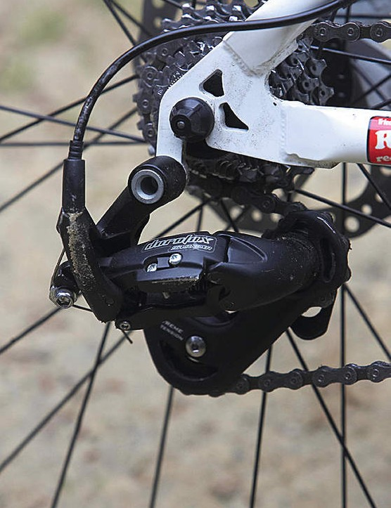 Tight-ratio gears are a racing giveaway. You'll need a chain tensioner to go singlespeed.