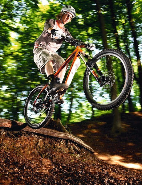 At the same time as pulling up, pedal your cranks round half a turn to loft the front wheel and to get you airborne