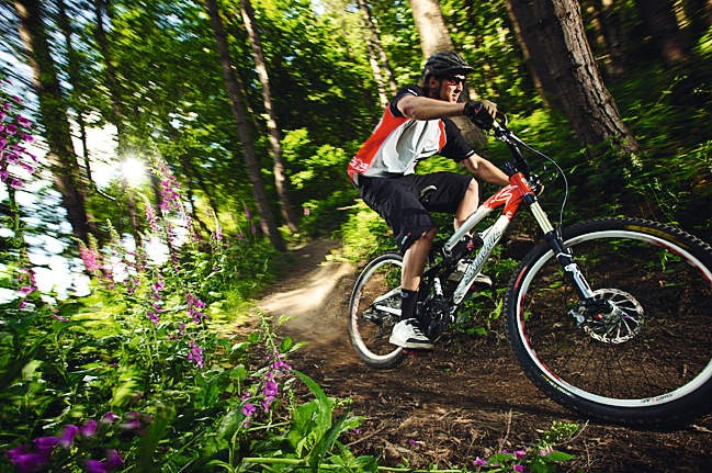 If your body stays balanced over the bike then you'll have a much better grip