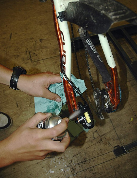 Remove the bleed hose and bottle from the nipple.