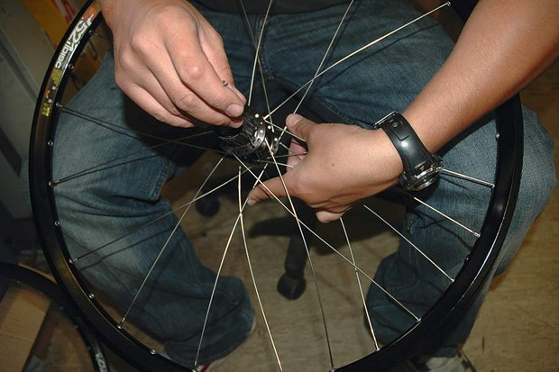 As you assemble the drive side you may need to flex already fixed spokes out of the way.