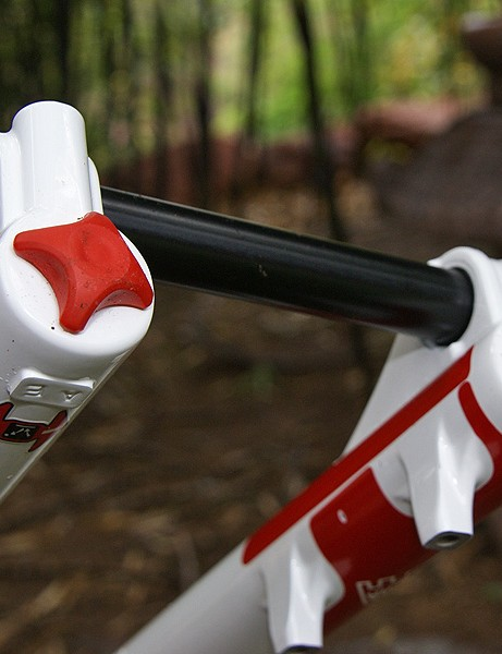 Lower knobs are plastic but Magura says they are less expensive to replace than aluminum ones.