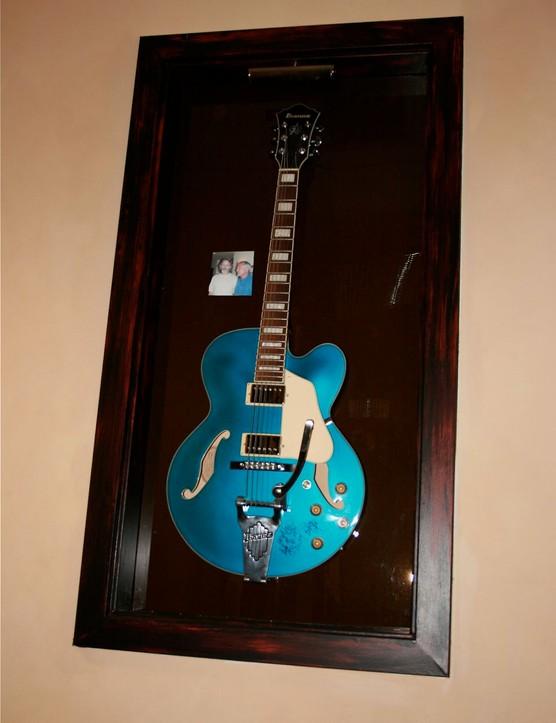 An autographed hollow-body electric guitar from avid Marin mountain biker, Grateful Dead guitarist Bob Weir.