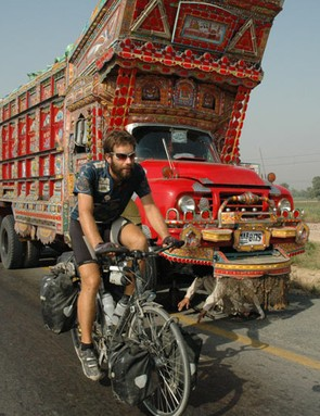 The psychedelic trucks of Pakistan keep Mark company for 800km whilst under police escort.