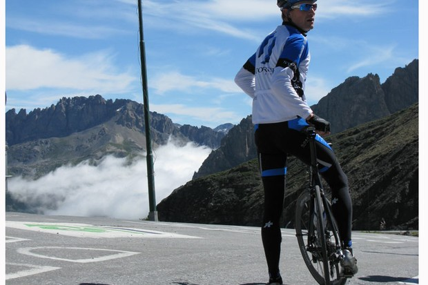 Martyn calls for his jacket atop the Galibier