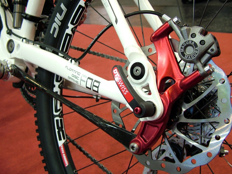 Merida has added a clean-looking floating disc brake mount to its higher-end One-Five-O and TransMission trail bikes.