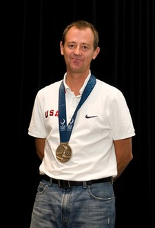 USA Cycling Jim Miller was awarded the Order of Ikkos medallion for his role in Kristin Armstrong's Olympic gold medal.