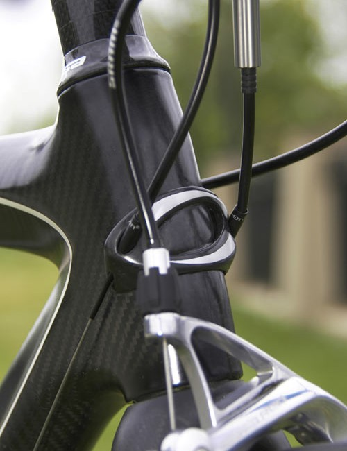 New head tube badge still serves double duty as the derailleur housing stop but is now carbon fibre
