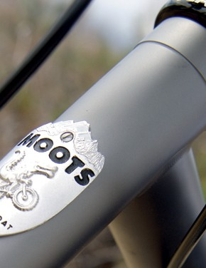 Understated gray finish underpins the Moots head badge