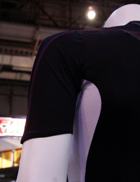 Asymmetrical sleeve cuts presumably will provide better coverage while in the cycling position.