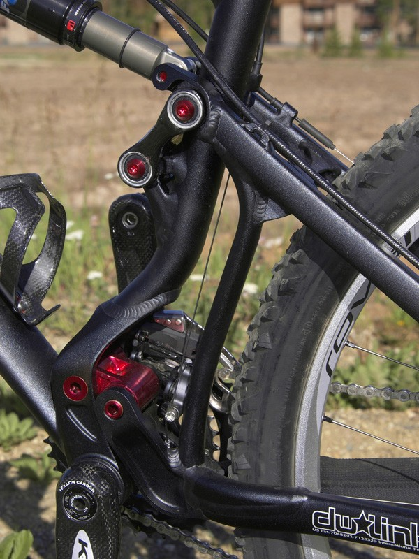 A pair of stout links carefully controls the movement of the rear end and keeps rear end flex in check