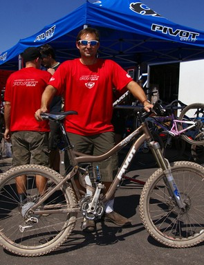 Pivot Cycles founder Chris Cocalis stands proudwith his new Firebird.