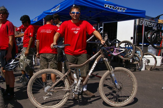 Pivot Cycles founder Chris Cocalis stands proud	with his new Firebird.