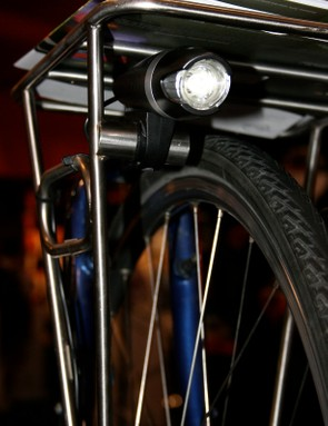 Planet Bike's Blaze Dynamo light works off a front hub generator, with a power reserve function to light your way after the wheel stops rotating.