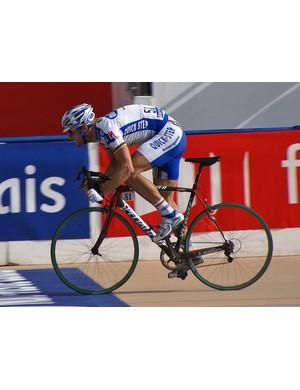 Tom Boonen surged past Fabian Cancellara and Alessandro Ballan to win his second Paris-Roubaix