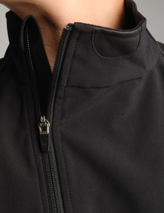 The asymmetrical zipper is supplemented	by a handy bite tab up top.